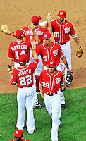25 September 2011: Washington Nationals shortstop Ian Desmond (6) celebrates with teammates after a game against the Atlanta Braves at Nationals Park in Washington, DC. The Nationals shut out the Braves 3-0 to take the rubber match third game of their 3-game series - the Nationals' final home game for the 2011 season. Mandatory Credit: Ed Wolfstein Photo