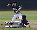 UC Davis second baseman Tino Lipson makes an out against Husky Will Ballowe in a college baseball game against University of Washington in Davis, Ca., on Saturday, Feb. 16, 2013. Davis won the opener 6-5 and dropped the second game 3-2..Photo by Cathleen Allison