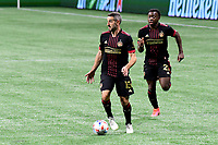 ATLANTA, GA - APRIL 24: Atlanta United forward #15 Lisandro Lopez dribbles the ball with defender #20 George Bello following during a game between Chicago Fire FC and Atlanta United FC at Mercedes-Benz Stadium on April 24, 2021 in Atlanta, Georgia.