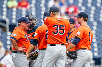 Cal State Fullerton head coach Rick Vanderhook (28) meets with his team on the mound during the NCAA College baseball World Series against the Vanderbilt Commodores Titans on June 15, 2015 at TD Ameritrade Park in Omaha, Nebraska. Vanderbilt beat Cal State Fullerton 4-3. (Andrew Woolley/Four Seam Images)