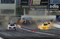 Feb. 21, 2010; Chandler, AZ, USA; NHRA funny car driver Jeff Arend (right) goes sideways as he races alongside Jim Head during the Arizona Nationals at Firebird International Raceway. Mandatory Credit: Mark J. Rebilas-