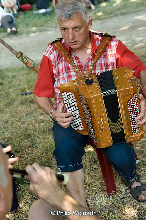 A musician plays a diatonic accordion at the 31st International Festival of Luthiers and Maitres Sonneurs, in Saint Chartier, France.