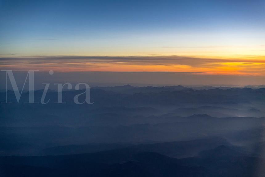 Mountain range aerial at dawn, Spain.