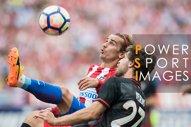 Antoine Griezmann (L)  of Atletico de Madrid fights for the ball with Yeray Alvarez Lopez (R) of Athletic Club during their La Liga match between Atletico de Madrid vs Athletic de Bilbao at the Estadio Vicente Calderon on 21 May 2017 in Madrid, Spain. Photo by Diego Gonzalez Souto / Power Sport Images