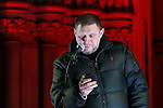 """© Joel Goodman - 07973 332324 .  03/02/2015 . Manchester , UK . Madchester star SHAUN RYDER reads a short speech from his phone to the crowd , at the demonstration . Demonstration organised by the Labour Party on the steps of Manchester City Council in Albert Sqaure , Manchester , under the banner """"manVcam"""" ( Manchester vs Cameron ) . Organisers say Manchester - along with Liverpool and Birmingham - have suffered larger cuts than other regional authorities , whilst southern regions such as Surrey , Hampshire and West Sussex have all seen increases in government funding . Photo credit : Joel Goodman"""