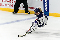 WORCESTER, MA - JANUARY 16: Lilly Feeney #22 of Holy Cross controls the puck during a game between Boston College and Holy Cross at Hart Center Rink on January 16, 2021 in Worcester, Massachusetts.