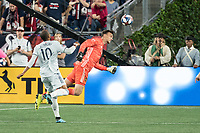 FOXBOROUGH, MA - AUGUST 4: Tyler Miller #1 of Los Angeles FC heads the ball away from the goal during a game between Los Angeles FC and New England Revolution at Gillette Stadium on August 3, 2019 in Foxborough, Massachusetts.