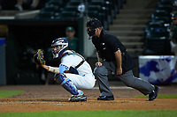 North Carolina Tar Heels catcher Cody Roberts (11) sets a target as home plate umpire Danny Everett looks on during the game against the Miami Hurricanes in the second semifinal of the 2017 ACC Baseball Championship at Louisville Slugger Field on May 27, 2017 in Louisville, Kentucky. The Tar Heels defeated the Hurricanes 12-4. (Brian Westerholt/Four Seam Images)