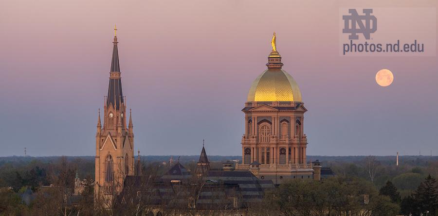 May 7, 2020; Moonset behind campus skyline (Photo by Matt Cashore/University of Notre Dame)