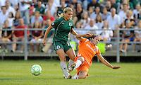 Keeley Dowling (orange) makes a slide tackle on Amanda Cinalli,.Sky Blue FC defeated Saint Louis Athletica 1-0 at Anheuser-Busch Soccer Park, Fenton, MO.