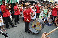 Brass band playing at a barangay fiesta; Santa Mesa, Manila. 18 May 2003