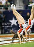 A Illinois Fighting Illini cheerleader does a flip after Illinois scores during the 2010 Texas  Bowl football game between the Illinois  Fighting Illini and the Baylor Bears at the Reliant Stadium in Houston, Tx. Illinois defeats Baylor 38 to 14....