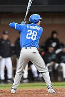 Right fielder Ryan Johnson (28) of the Kentucky Wildcats bats in a game in the rain against the University of South Carolina Upstate Spartans on Saturday, February 17, 2018, at Cleveland S. Harley Park in Spartanburg, South Carolina. Kentucky won, 6-5, in 10 innings. (Tom Priddy/Four Seam Images)