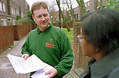 Caretaker talks with a resident on a Camden Council housing estate