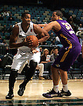 Reno Bighorns Hassan Whiteside pushes past Los Angeles D-Fenders' Brandon Costner duruing a basketball game in Reno, Nev., on Friday, Jan. 6, 2012. The D-Fenders won 109-78..Photo by Cathleen Allison