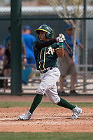 Oakland Athletics shortstop Brallan Perez (28) follows through on his swing during a Minor League Spring Training game against the Chicago Cubs at Sloan Park on March 13, 2018 in Mesa, Arizona. (Zachary Lucy/Four Seam Images)