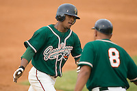 Osvaldo Martinez (1) of the Greensboro Grasshoppers is congratulated as he rounds third base following his solo home run in the 6th inning at Fieldcrest Cannon Stadium in Kannapolis, NC, Saturday August 24, 2008. (Photo by Brian Westerholt / Four Seam Images)