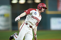 Heston Kjerstad (18) of the Arkansas Razorbacks hustles around third base during the game against the Baylor Bears in game nine of the 2020 Shriners Hospitals for Children College Classic at Minute Maid Park on March 1, 2020 in Houston, Texas. The Bears defeated the Razorbacks 3-2. (Brian Westerholt/Four Seam Images)