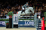 Ludger Beerbaum of Germany riding Colestus in action during the Laiterie De Montaigu Trophy as part of the Longines Hong Kong Masters on 14 February 2015, at the Asia World Expo, outskirts Hong Kong, China. Photo by Victor Fraile / Power Sport Images