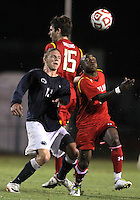 COLLEGE PARK, MD. - AUGUST 20, 2012:  Ryan Reid (26) of  the University of Maryland goes for a high ball with Owen Griffith (12) of Penn State during an NCAA match at Ludwig Field, in College Park, Maryland on August 20. The game ended in a 2-2 tie.