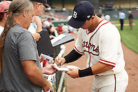Birmingham Barons Martin Medina signs autographs before the 20th Annual Rickwood Classic Game against the Jacksonville Suns on May 27, 2015 at Rickwood Field in Birmingham, Alabama.  Jacksonville defeated Birmingham by the score of 8-2 at the countries oldest ballpark, Rickwood opened in 1910 and has been most notably the home of the Birmingham Barons of the Southern League and Birmingham Black Barons of the Negro League.  (Mike Janes/Four Seam Images)