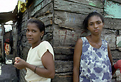 Residents of the crowded riverside barrio of Capotillo, Santo Domingo, where houses have no running water or sanitation