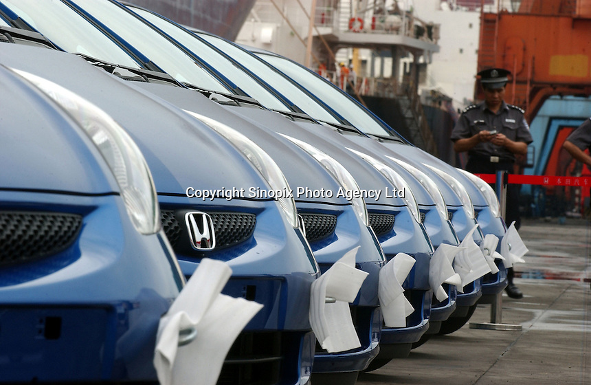 Newly produced Honda Jazz motor cars are lined up for export at a port in Guangzhou, China prior to a ceremony for the first cars exported. Honda Motor Export Plant in Guangzhou, China, produce and export the Honda Jazz model. .