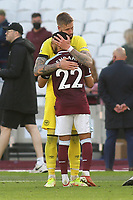 Brentford's Pontus Jansson hugs ex Brentford player, Said Benrahma  at the end of the match during West Ham United vs Brentford, Premier League Football at The London Stadium on 3rd October 2021