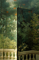 Hand-painted trompe l'oeil woodland scenes cover the walls and concealed doors of the rotunda