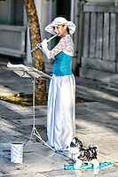 A musician playing flute in the street of Athens, Greece