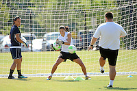 Goalkeeper Hope Solo fields a ball as Jillian Loyden looks on during the Women's Professional Soccer (WPS) All-Star practice at KSU Stadium in Kennesaw, GA, on June 29, 2010.