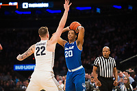 NEW YORK, NY - Thursday March 9, 2017: Desi Rodriguez (#20) of Seton Hall looks for a pass against Katin Reinhardt (#22) of Marquette as the two schools square off in the Quarterfinals of the Big East Tournament at Madison Square Garden.
