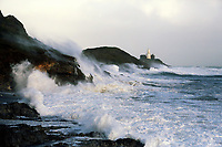 """Pictured: Waves crash against Mumbles Lighhouse in Bracelet Bay, Swansea, UK. Monday 16 October 2017<br />Re: Remnants of Hurricane Ophelia are expected to bring strong gusts of wind to Wales when it hits Britain's shores.<br />The hurricane, making its way from the Azores in the Atlantic Ocean, will have weakened to a storm when it arrives.<br />A Met Office amber """"be prepared"""" warning has been issued in some areas bringing """"potential danger to life""""."""