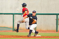 First baseman Dan Vogelbach #59 of Team Blue stretches for a throw as Michael Lorenzen #2 of Team Red crosses the bag during the USA Baseball 18U National Team Trials at the USA Baseball National Training Center on June 30, 2010, in Cary, North Carolina.  Photo by Brian Westerholt / Four Seam Images
