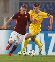 Calcio, Champions League: Gruppo E - Roma vs Bate Borisov. Roma, stadio Olimpico, 9 dicembre 2015.<br /> Roma's Lucas Digne, left, is challenged by Bate Borisov's Aleksandr Karnitski during the Champions League Group E football match between Roma and Bate Borisov at Rome's Olympic stadium, 9 December 2015.<br /> UPDATE IMAGES PRESS/Riccardo De Luca