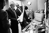 Phoenix, Arizona.USA.January 28, 2004..General Wesley Clark, moments after addressing a crowd of supporters, as he signs posters and momentos back stage.