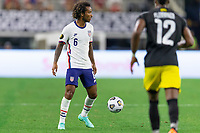 DALLAS, TX - JULY 25: Gianluca Busio #6 of the United States moves with the ball during a game between Jamaica and USMNT at AT&T Stadium on July 25, 2021 in Dallas, Texas.