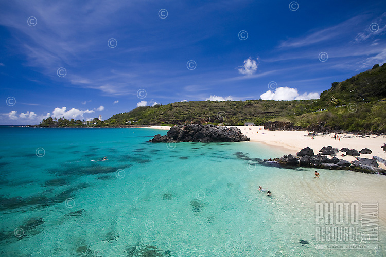 People snorkeling, swimming and enjoying the sun at Waimea Bay on the North Shore of Oahu