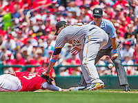 21 June 2015: Washington Nationals outfielder Michael Taylor dives safely back to first, as Pittsburgh Pirates first baseman Corey Hart is unable to hold onto the throw during game action at Nationals Park in Washington, DC. The Nationals defeated the Pirates 9-2 to sweep their 3-game weekend series, and improve their record to 37-33. Mandatory Credit: Ed Wolfstein Photo *** RAW (NEF) Image File Available ***