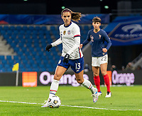 LE HAVRE, FRANCE - APRIL 13: Alex Morgan #13 of the USWNT dribbles during a game between France and USWNT at Stade Oceane on April 13, 2021 in Le Havre, France.