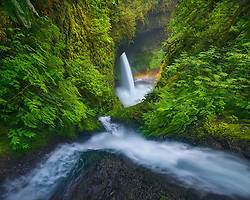 Cascades converge in a steep canyon, leading to a large waterfall below.<br /> Artist Edition: 15/100 Limited