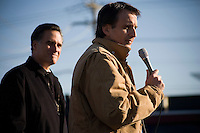 """Former governor of Minnesota and Republican presidential candidate Tim Pawlenty (brown jacket) speaks to the public in support of Republican presidential candidate Mitt Romney, former governor of Massachusetts, during a rally in Manchester, New Hampshire, on Sat. Dec. 3, 2011. The rally was called, """"Earn It with Mitt,"""" and was designed to bolster local efforts to help Romney """"earn"""" voters' support for the upcoming Republican primary."""