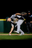 September 28, 2008: Oakland Athletics second baseman Cliff Pennington fumbles a slow roller during a game against the Seattle Mariners at Safeco Field in Seattle, Washington.