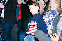 A boy wearing a USA sweater and campaign sticker stands in the audience before Texas senator and Republican presidential candidate Ted Cruz speaks at a town hall at Crossing Life Church in Windham, New Hampshire, on Tues. Feb. 2, 2016. The day before, Cruz won the Iowa caucus.