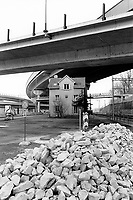 Switzerland. Canton Zürich. Zürich. An old house stands in the middle of the construction of a new highway. Train rails. Road signs. Building site. No parking sign. © 2007 Didier Ruef