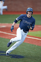 Hunter Dula (17) of the Wingate Bulldogs hustles down the first base line against the Concord Mountain Lions at Ron Christopher Stadium on February 1, 2020 in Wingate, North Carolina. The Bulldogs defeated the Mountain Lions 8-0 in game one of a doubleheader. (Brian Westerholt/Four Seam Images)