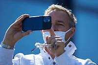 Former Major League pitcher Al Leiter uses his smartphone to take video of the celebration on the field after his son, Jack Leiter (not pictured), completed a no-hitter against the South Carolina Gamecocks at Hawkins Field on March 20, 2021 in Nashville, Tennessee. (Brian Westerholt/Four Seam Images)