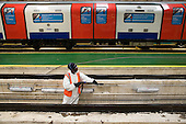 Spray cleaning grease from a maintenance channel at London Underground's Northumberland Park Depot, which services the 42 tube trains on the Victoria line. The channel allows engineers to work underneath the carriages without the use of cranes.