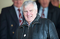 Former Scotland and Leeds United player, Peter Lorimer, takes his seat in the stand at Gayfield Park.