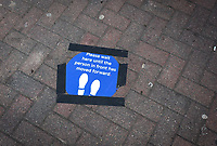 High Wycombe, UK. 16th April, 2020.<br /> Information of social distancing is taped to the floor outside a Tesco Express shop during the Covid-19 Pandemic as the UK Government advice to maintain social distancing and minimise time outside in High Wycombe on 16 April 2020. Photo by PRiME Media Images